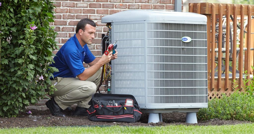 an hvac technician repairing equipment