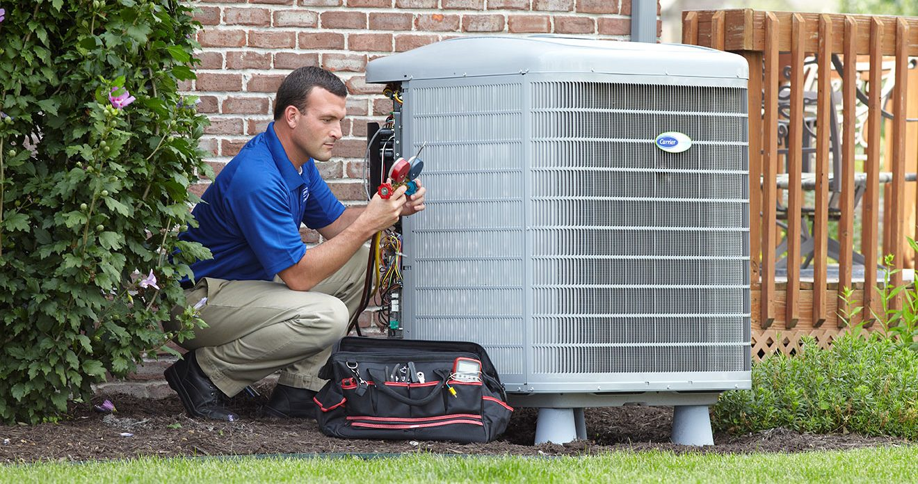 a technician repairing an air conditioning unit